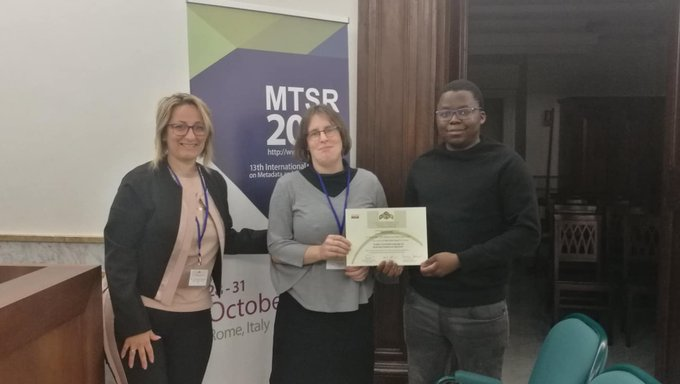 Associate Professor Maria Keet (centre) with Zola Mahlaza (tight) at MTSR 2019. Photo: MTSR
